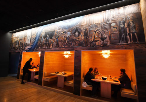 A Glenn Barr mural runs the length of a wall of tables at Antihero.  Restaurant review of Antihero in Ferndale, Michigan on December 28, 2018.  (Image by Daniel Mears / The Detroit News)